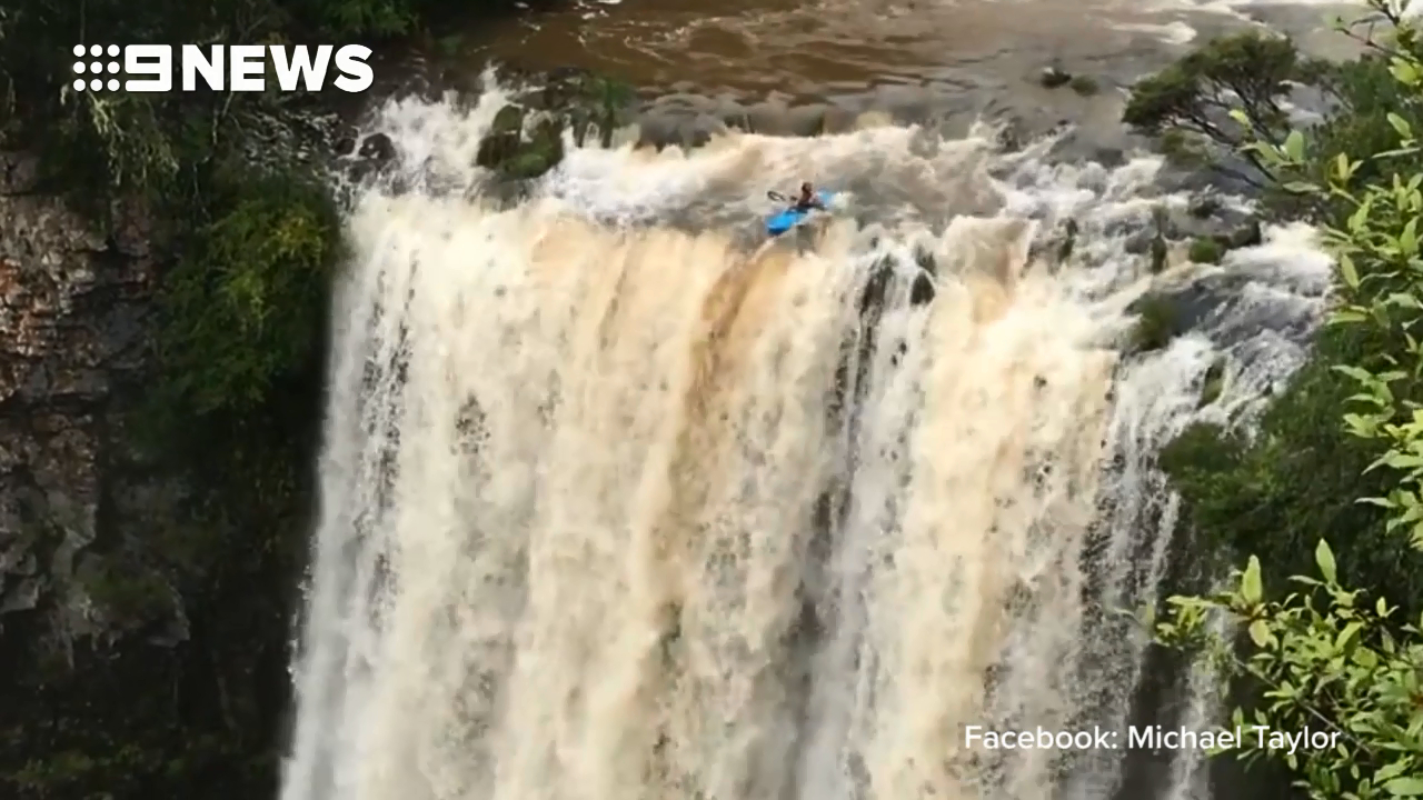 Thrill-seeking kayaker descends Dangar Falls