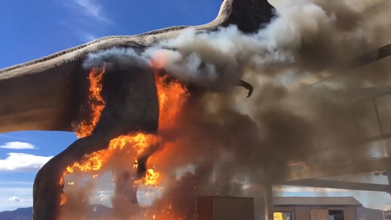 Giant T-Rex bursts into flames