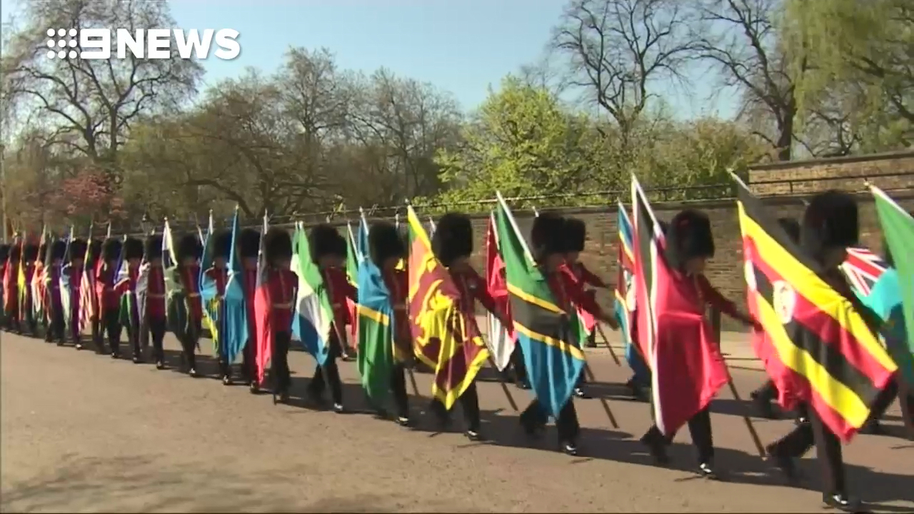 Queens guards march Commonwealth flags at CHOGM parade