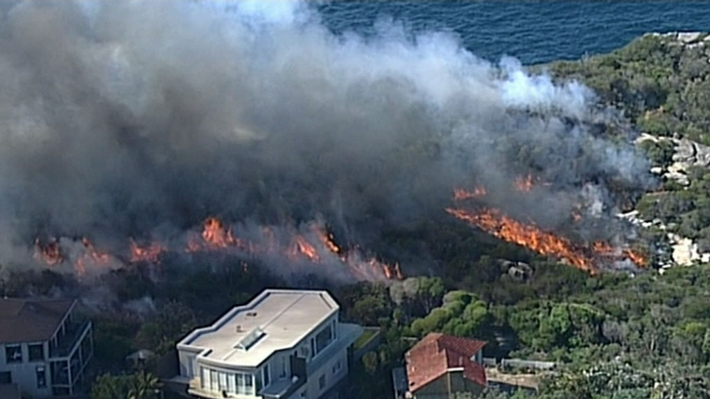 Reduction burn nears mansions on northern beaches