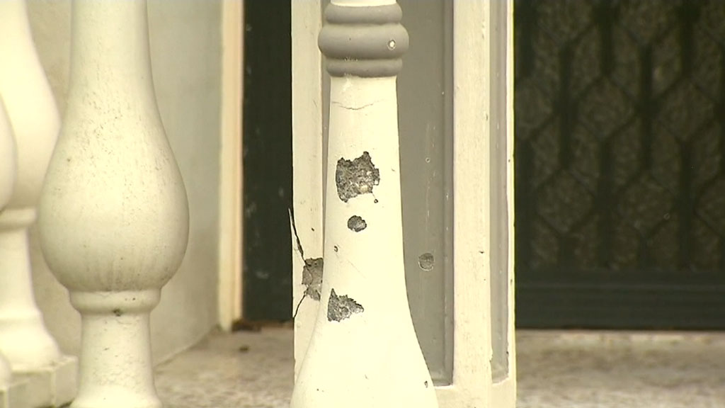 Grenade thrown at home with mum and baby inside