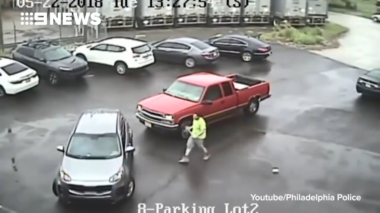 Man attacks SUV and man with sledgehammer