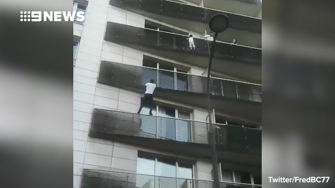 Hero climbs four storeys to rescue child