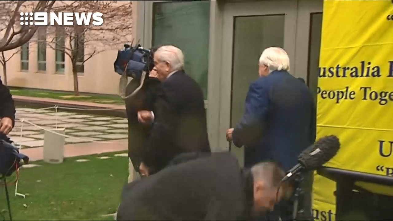 Clive Palmer's train wreck media conference washed out by Senate courtyard sprinklers
