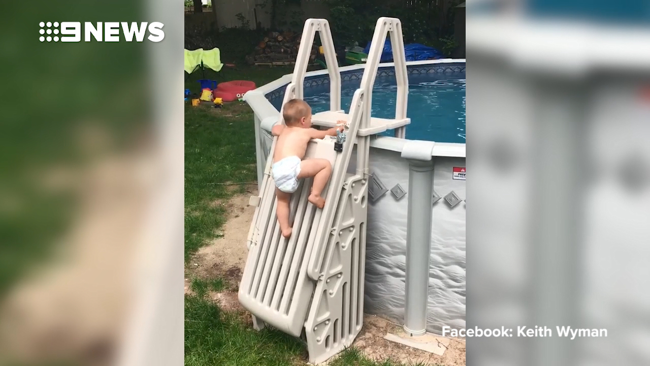 Toddler scales 'locked' pool ladder