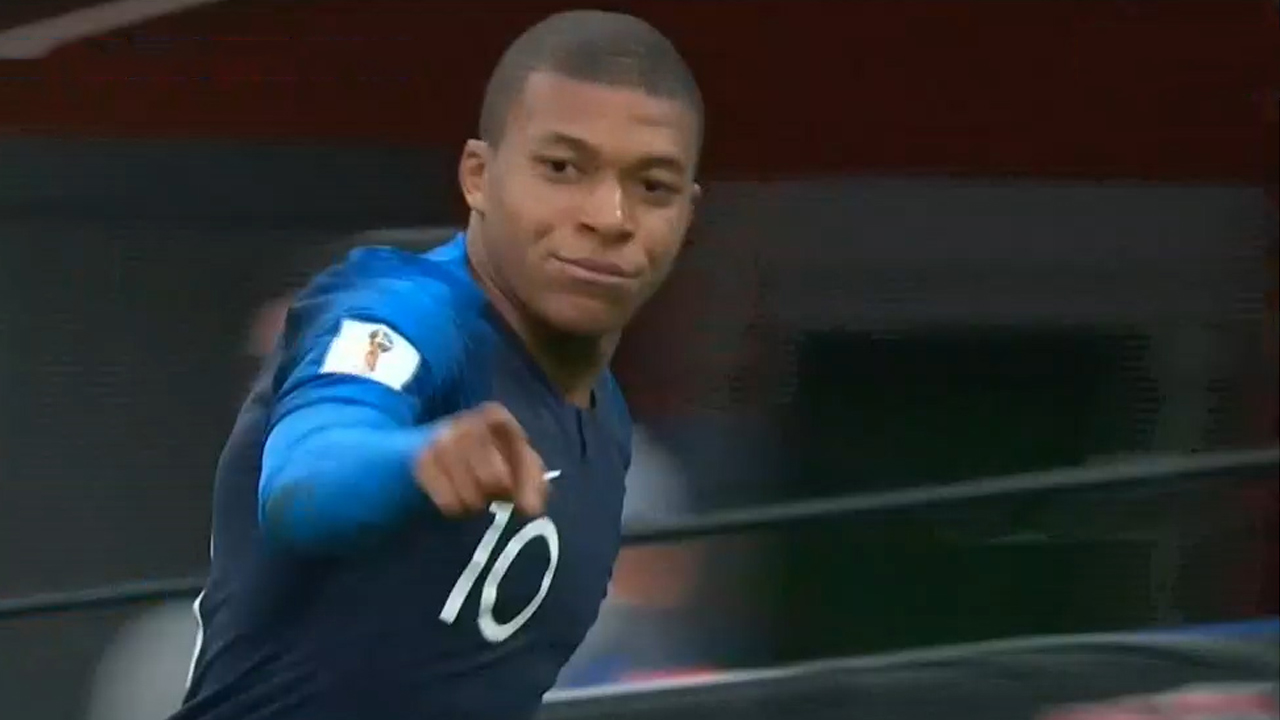 France progress with win over Peru