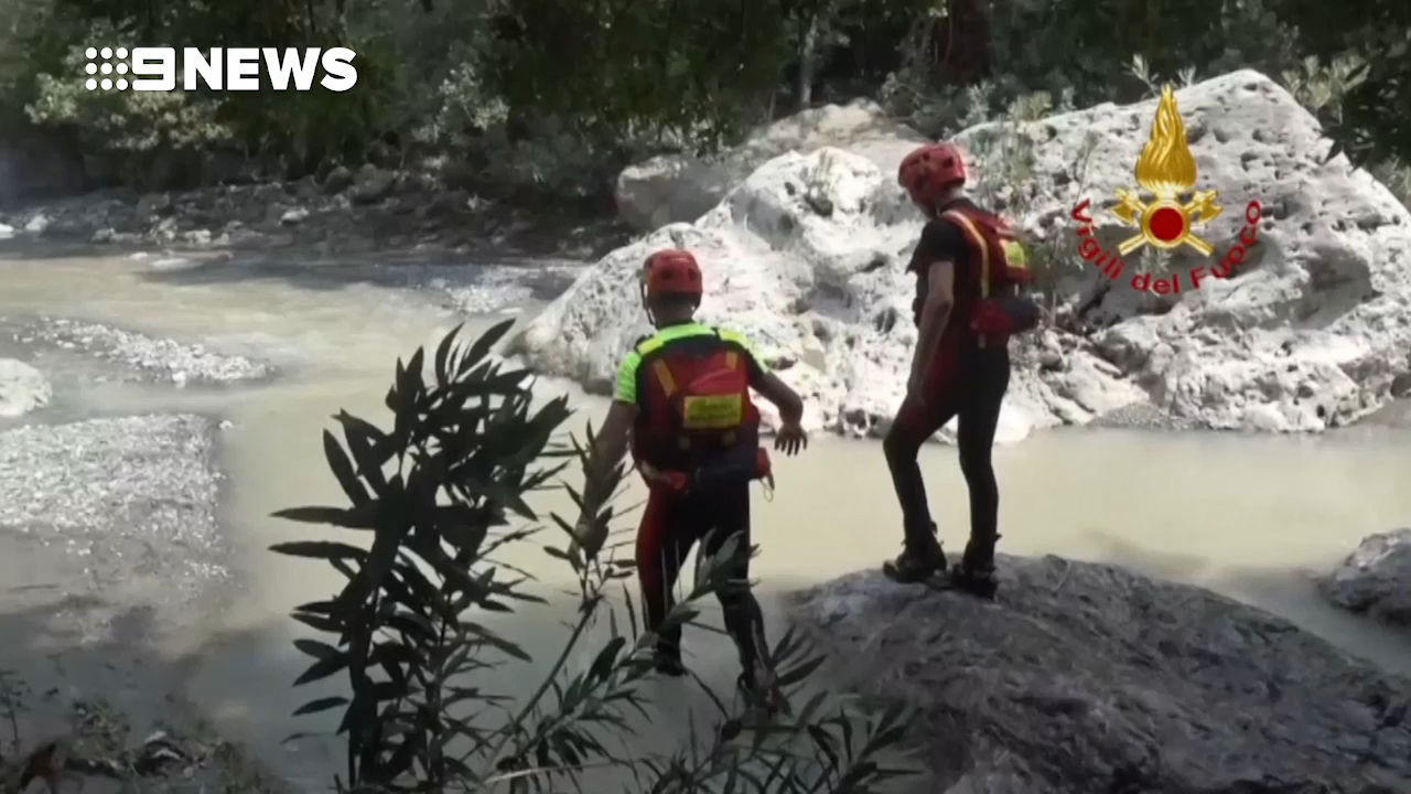 Rescuers search for victims of flash flood