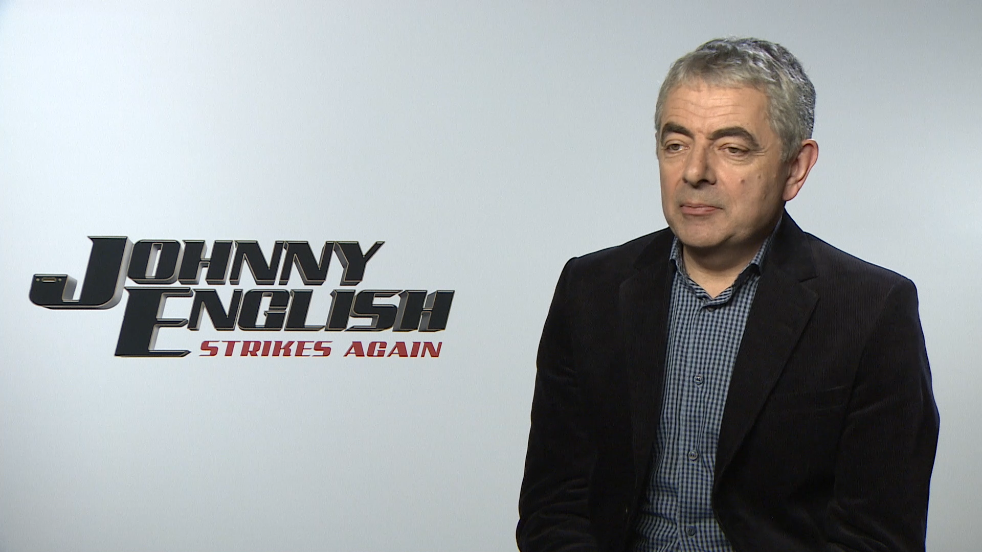 "Rowan Atkinson says he's ""faking it till he makes it"" as an actor"