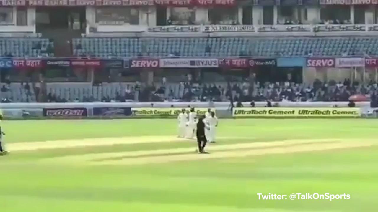 Cricket fan tries to kiss Kohli