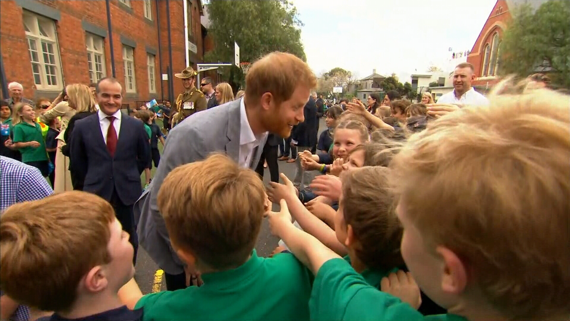 Prince Harry and Meghan mingle with school kids