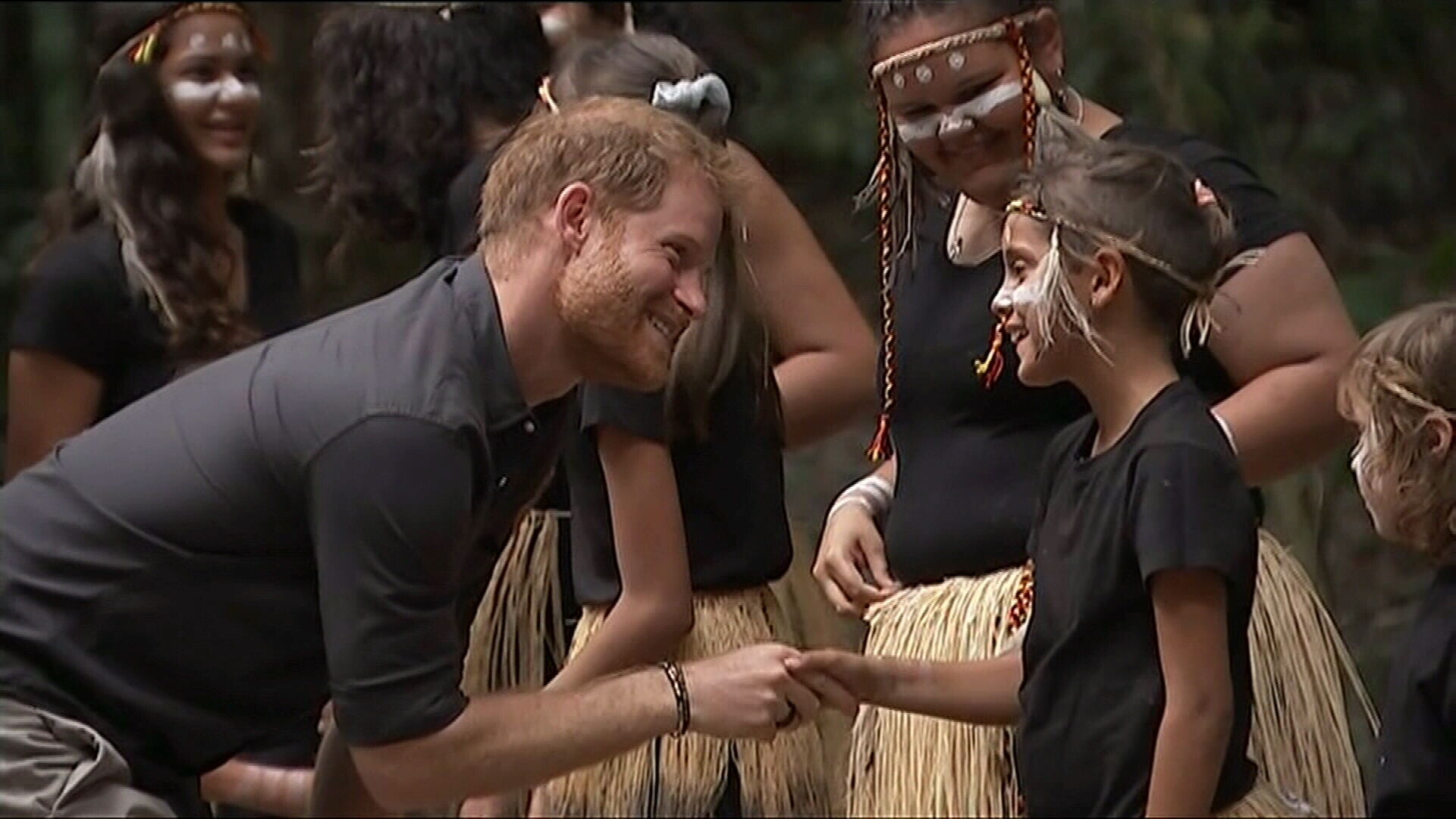Prince Harry meets locals at Pile Valley