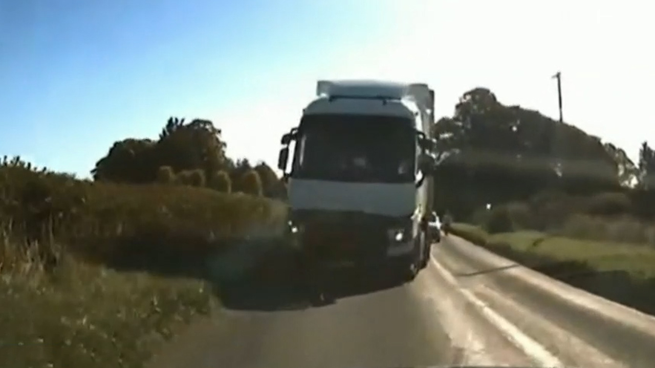 Moment truck hurtles towards BMW on wrong side of road