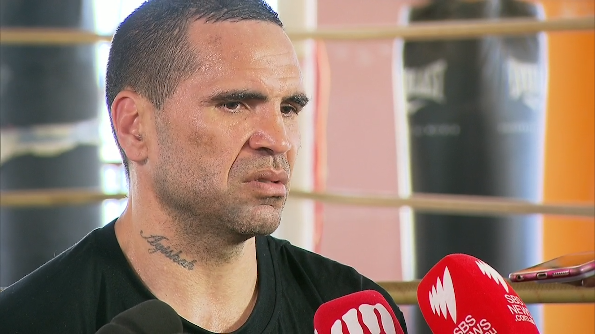 Emotional Mundine slams anthem