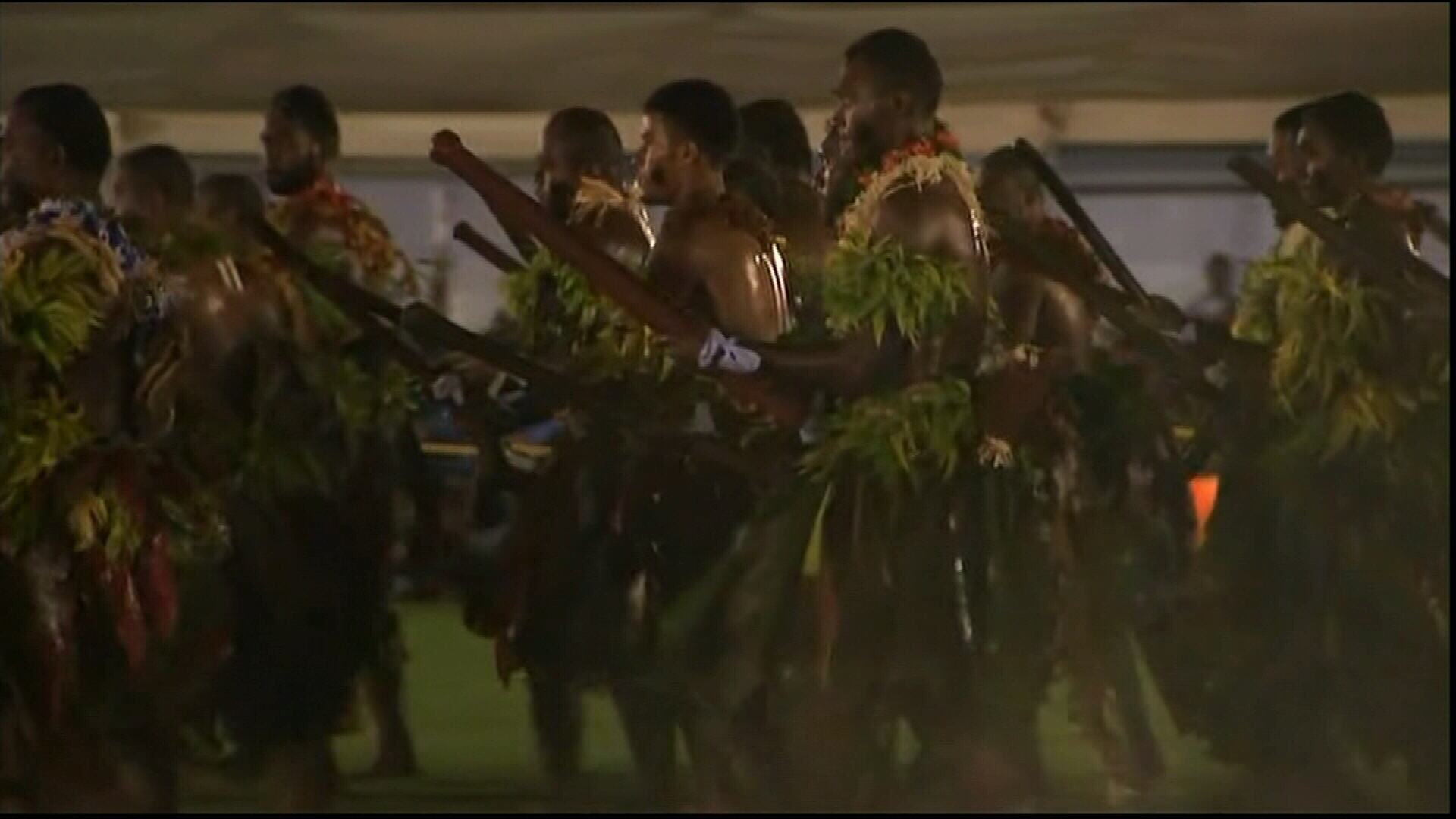 Fijian men perform for royal couple