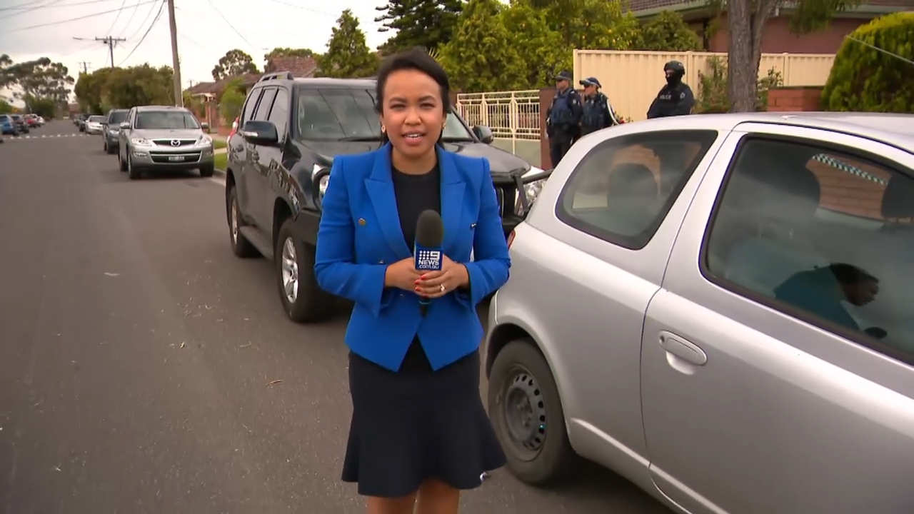 9NEWS reporter Neary Ty at terror raids