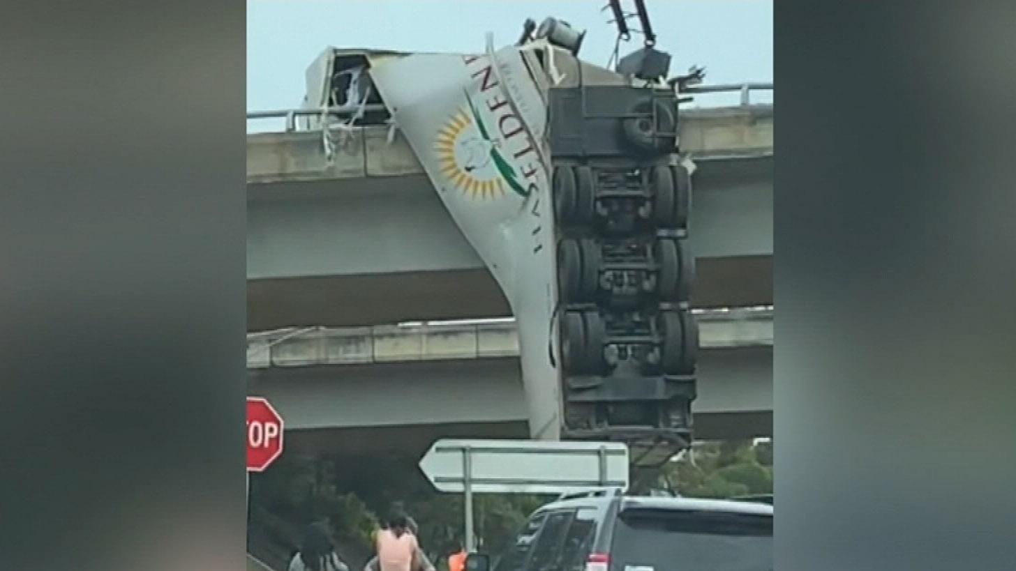 Truck crashes over edge of bridge on Calder Freeway