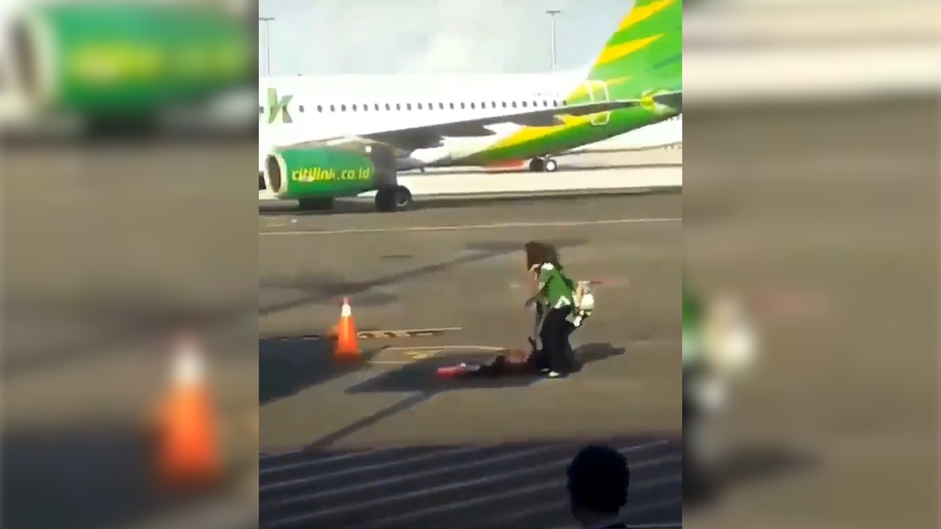 Woman's mad dash down tarmac after missing flight