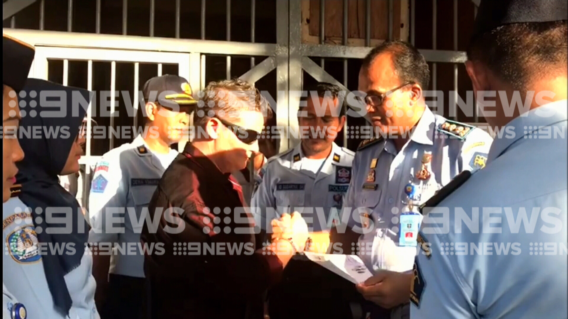 Smiling Renae Lawrence thanks prison guards