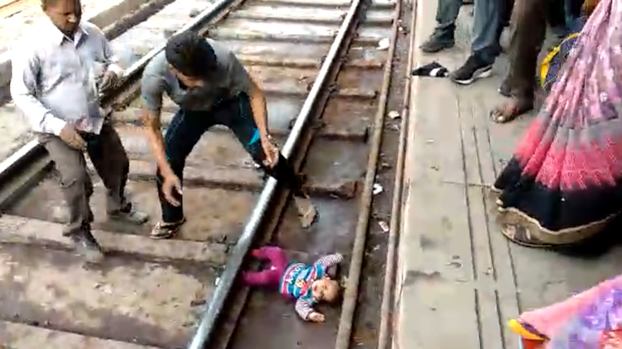 Baby survives after falling on tracks in India