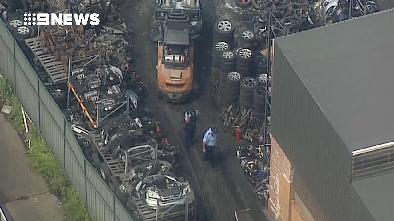 Emergency services rush to car yard explosion