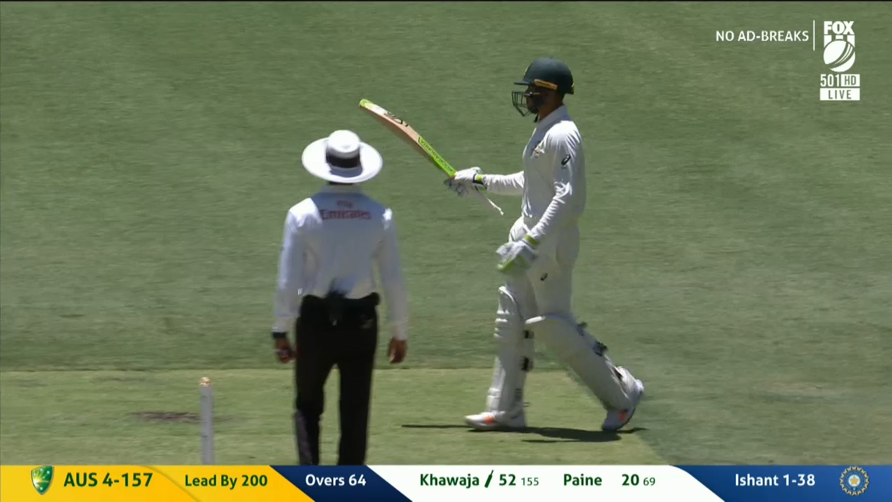 Khawaja reaches 50