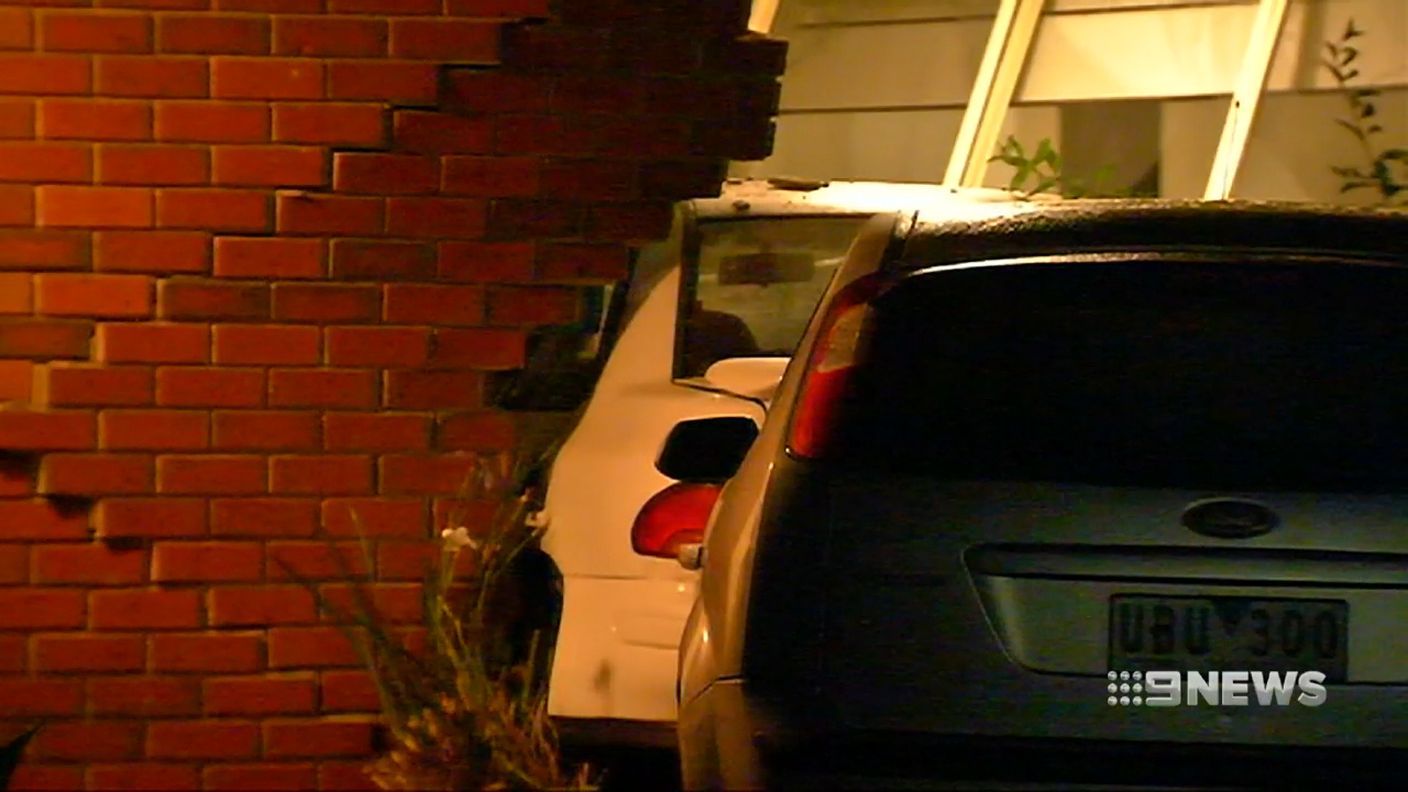 Woman charged after crashing car into ex-boyfriend's home