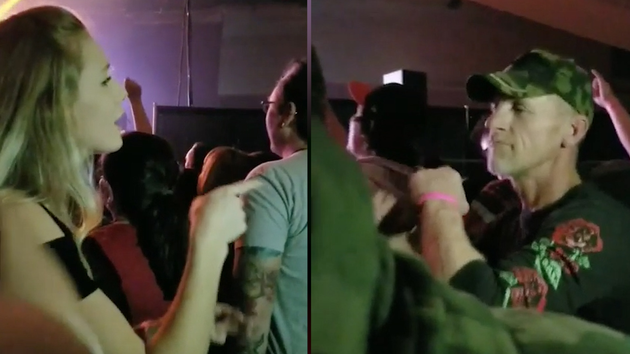Daughter signs for hearing impaired father at rock concert
