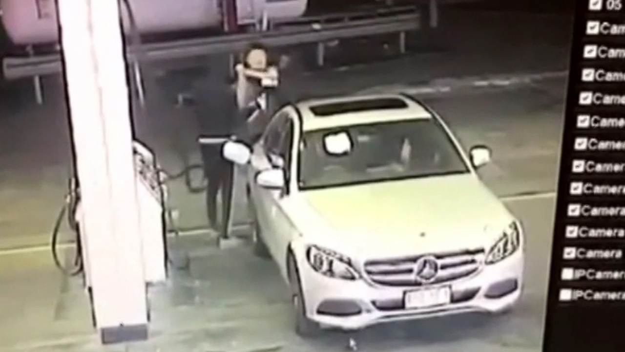 Manhunt underway as carjackers stalk, attack driver at Brisbane petrol station