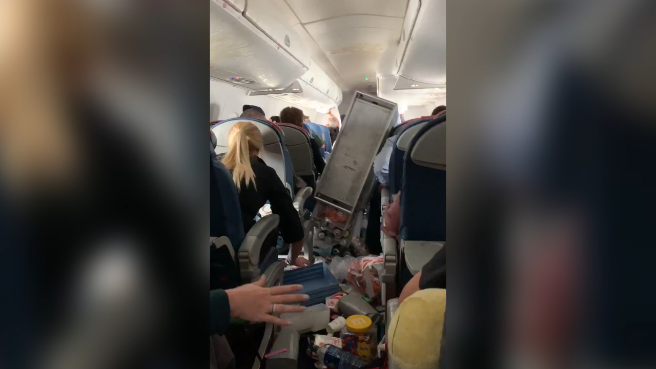 Extreme turbulence made plane nosedive twice and sent drink carts flying injuring five
