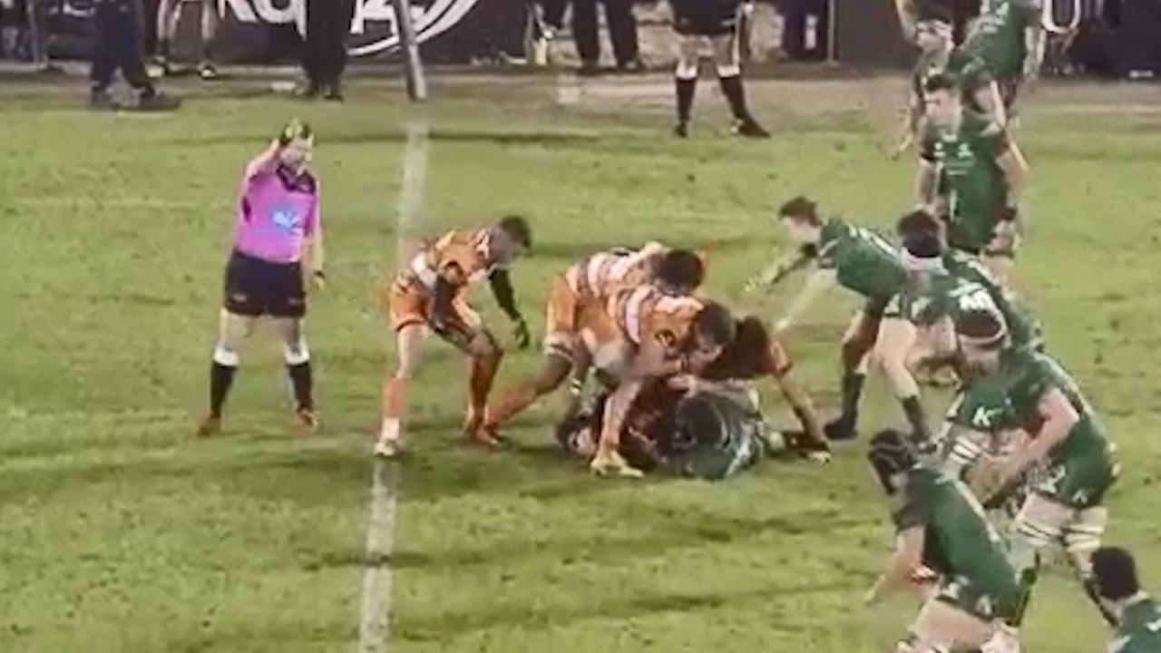 Rugby player blows nose on player