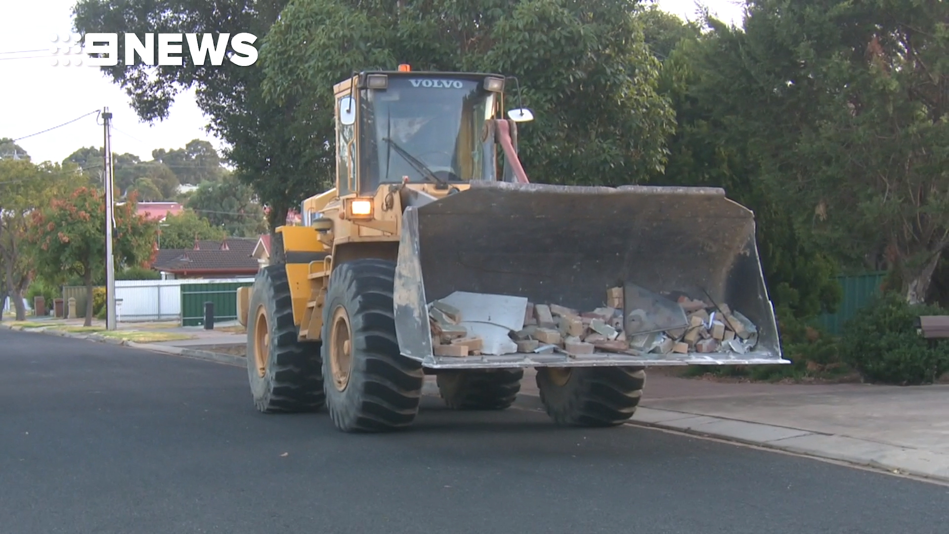 News Adelaide: Stolen front-end loader driven into hotel in