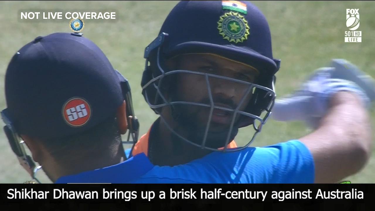 Dhawan brings up brisk half-century