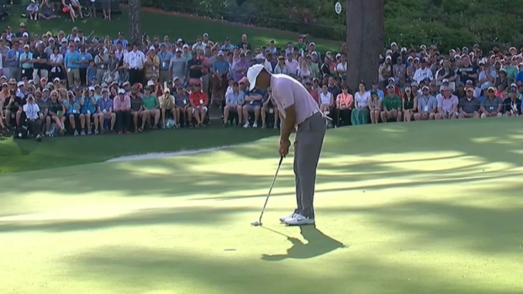Woods moves into a share of the lead