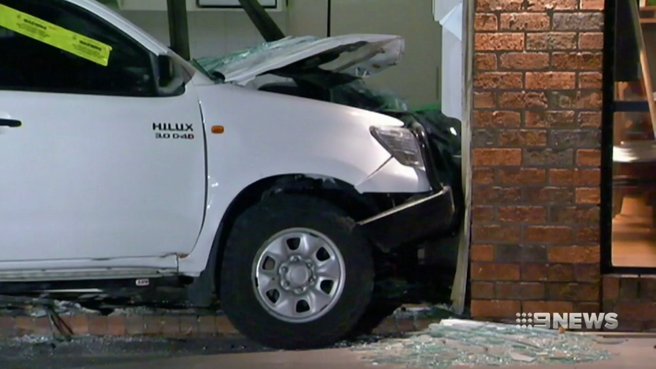 Stolen car slams into Melbourne shop front