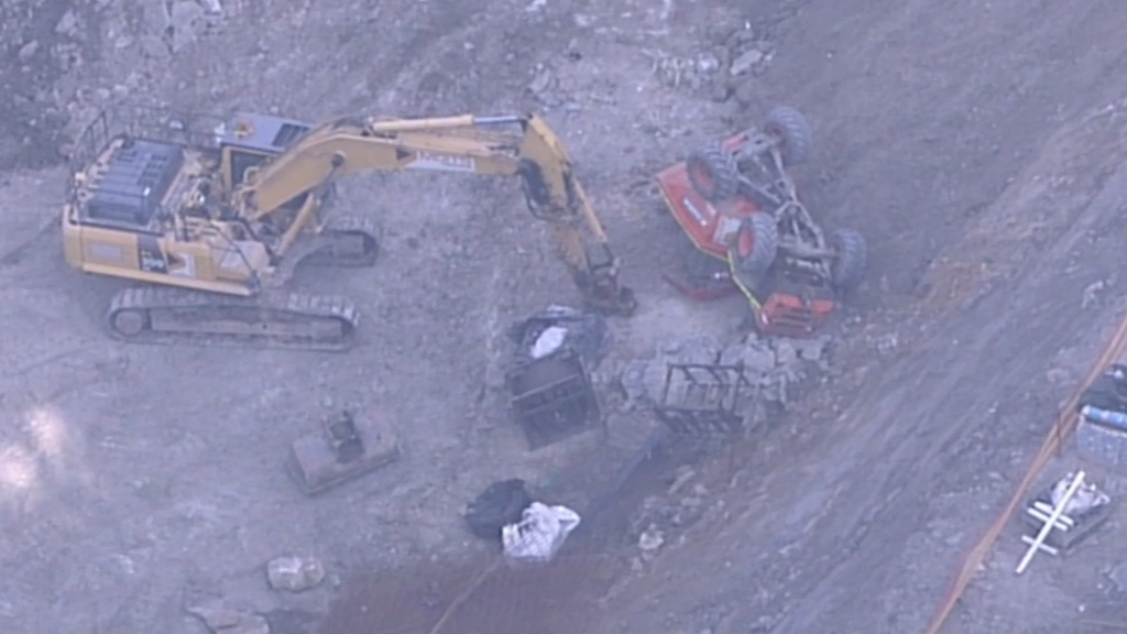 Man trapped under rolled truck at Sydney construction site