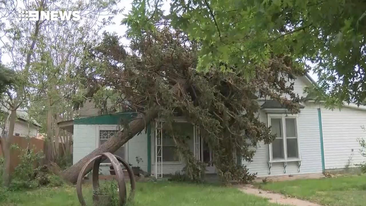 US residents assess tornado damage