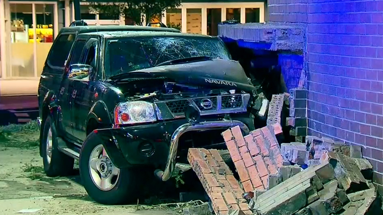 Man smashes car into library