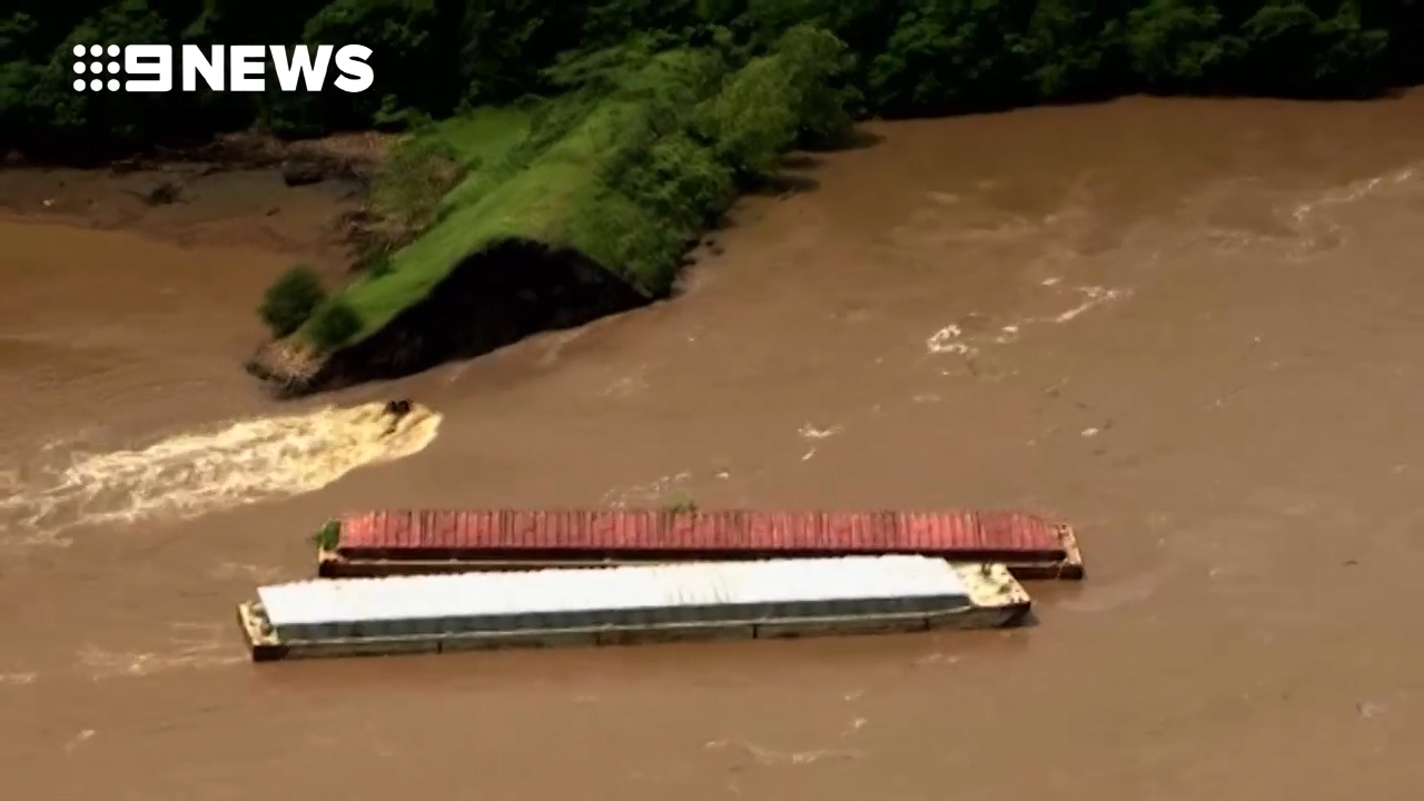 Runaway barges smash into dam