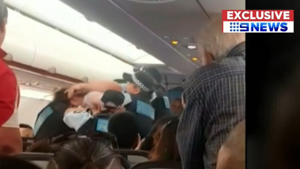 Man escorted off Jetstar flight after brutal clash