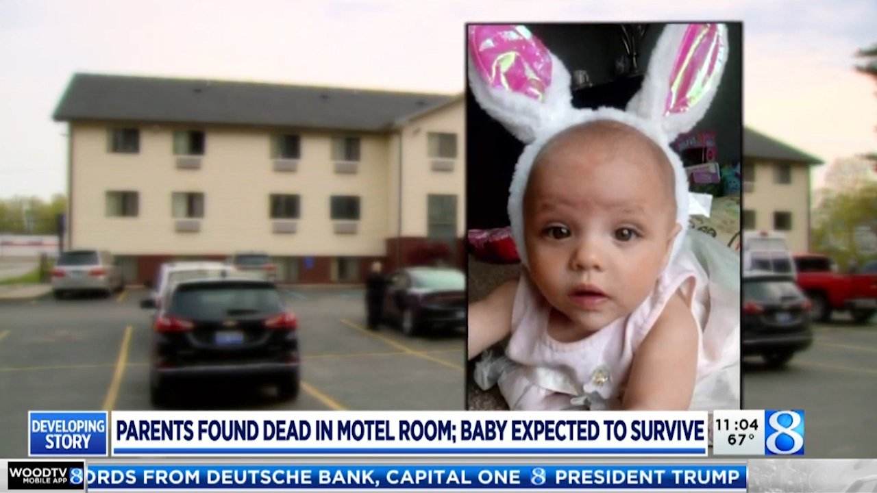Baby found with dead parents in US motel room