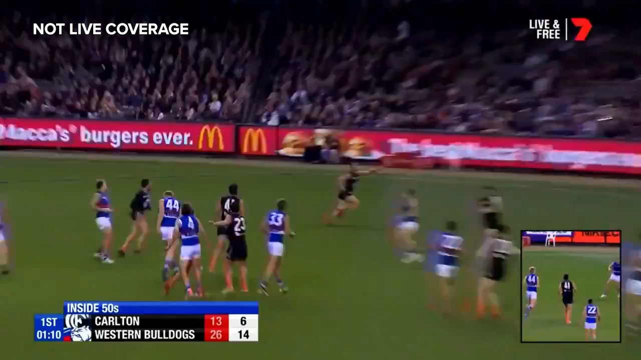 Western Bulldogs star Josh Dunkley juggles the ball onto the boot and somehow kicks a remarkable goal