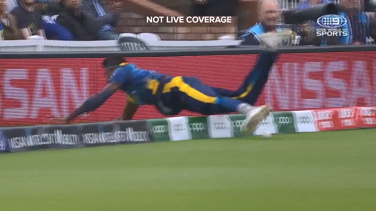 Sri Lanka's Isuru Udana hit the fence head first after chasing an Aaron Finch boundary
