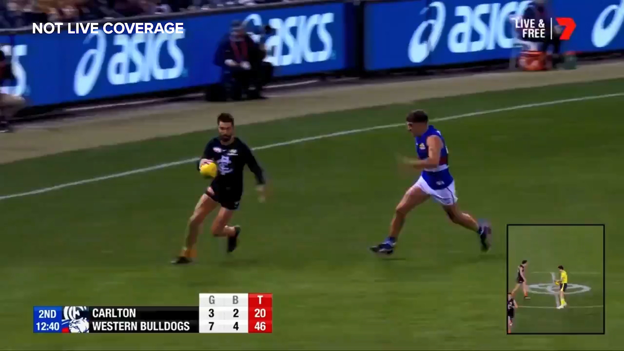 Western Bulldogs star Tom Liberatore goes off with an apparent knee injury against Carlton