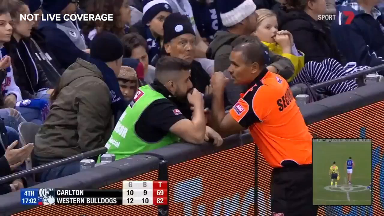 Former Bulldogs great Luke Darcy discusses fan behaviour as security guards evict two Carlton fans from Marvel Stadium