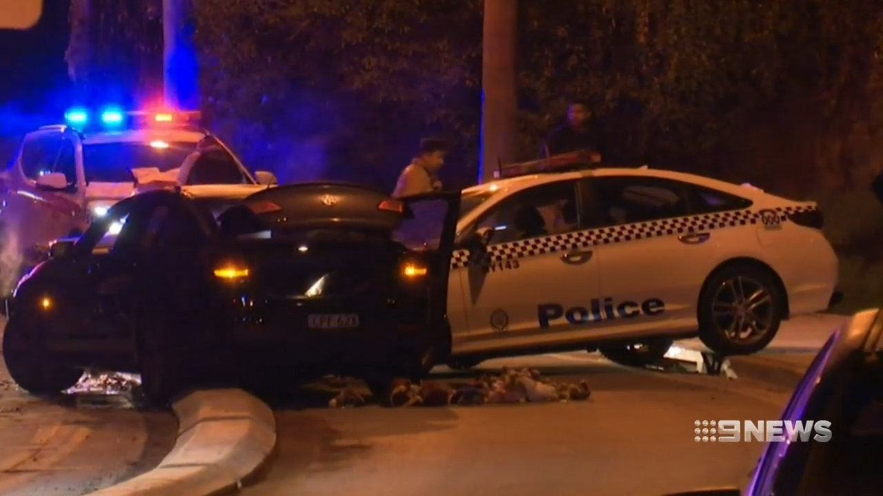 Sydney man charged after two police officers injured in head-on crash