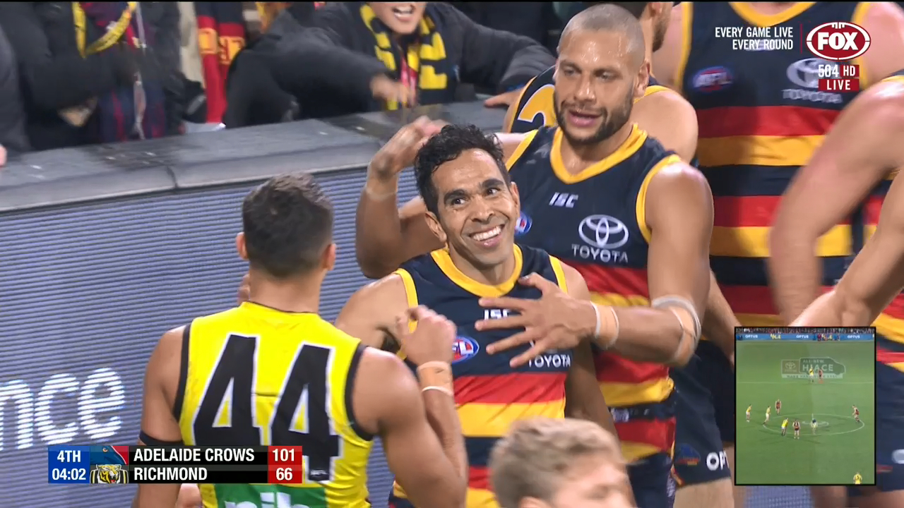 Richmond star Sydney Stack shows his appreciation for Adelaide star Eddie Betts' magical boundary line goal