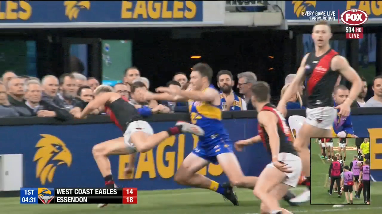 West Coast Eagles star Jeremy McGovern is reported after pushing Essendon's Matt Guelfi into the side board, leaving the Bombers star concussed