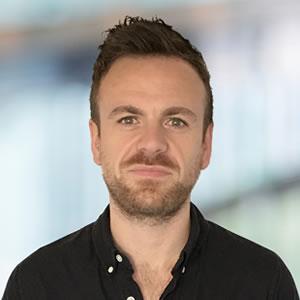 Portrait of Dan Leaning