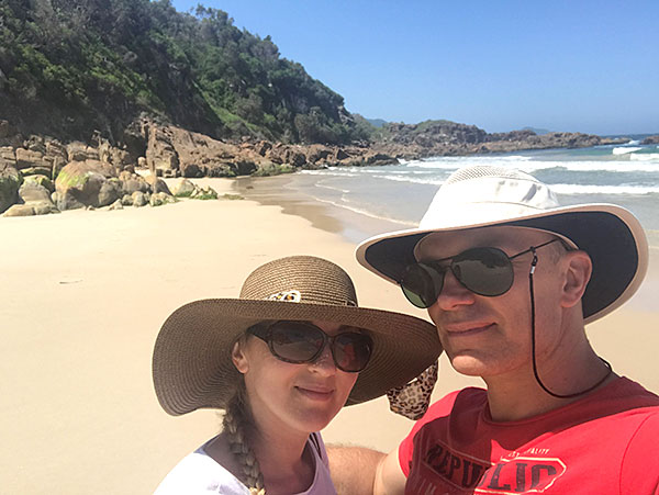 Paul and his wife on the beach