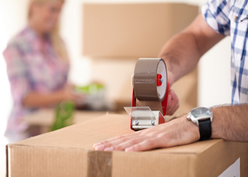 Couple Moving Houses Packing Boxes
